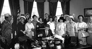 JFK signs the Equal Pay Act.